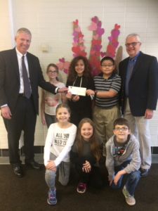 John Blecher (far left), CFO/COO of York Traditions Bank presents YSEF Board Member Bob Hildebrand and students from East York Elementary a generous EITC check to be used for district grant programs.