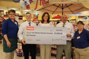Weis Markets presents YSEF President Sarah Reinecker with an EITC donation which is used to support innovative programs throughout the district.