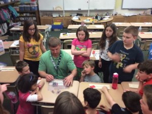 Students in Mr. Hare's 4th grade class at EY watch a demo on creating circuits. They then went into small groups to create their own- thanks for the electric circuit grant YSEF!